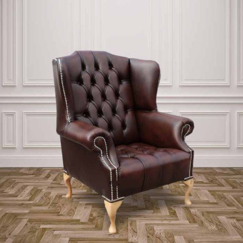 Chesterfield Stirling Buttoned Seat High Back Wing Chair Silver Studs UK Manufactured Antique Brown