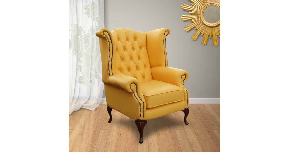 yellow chesterfield high back wing chair
