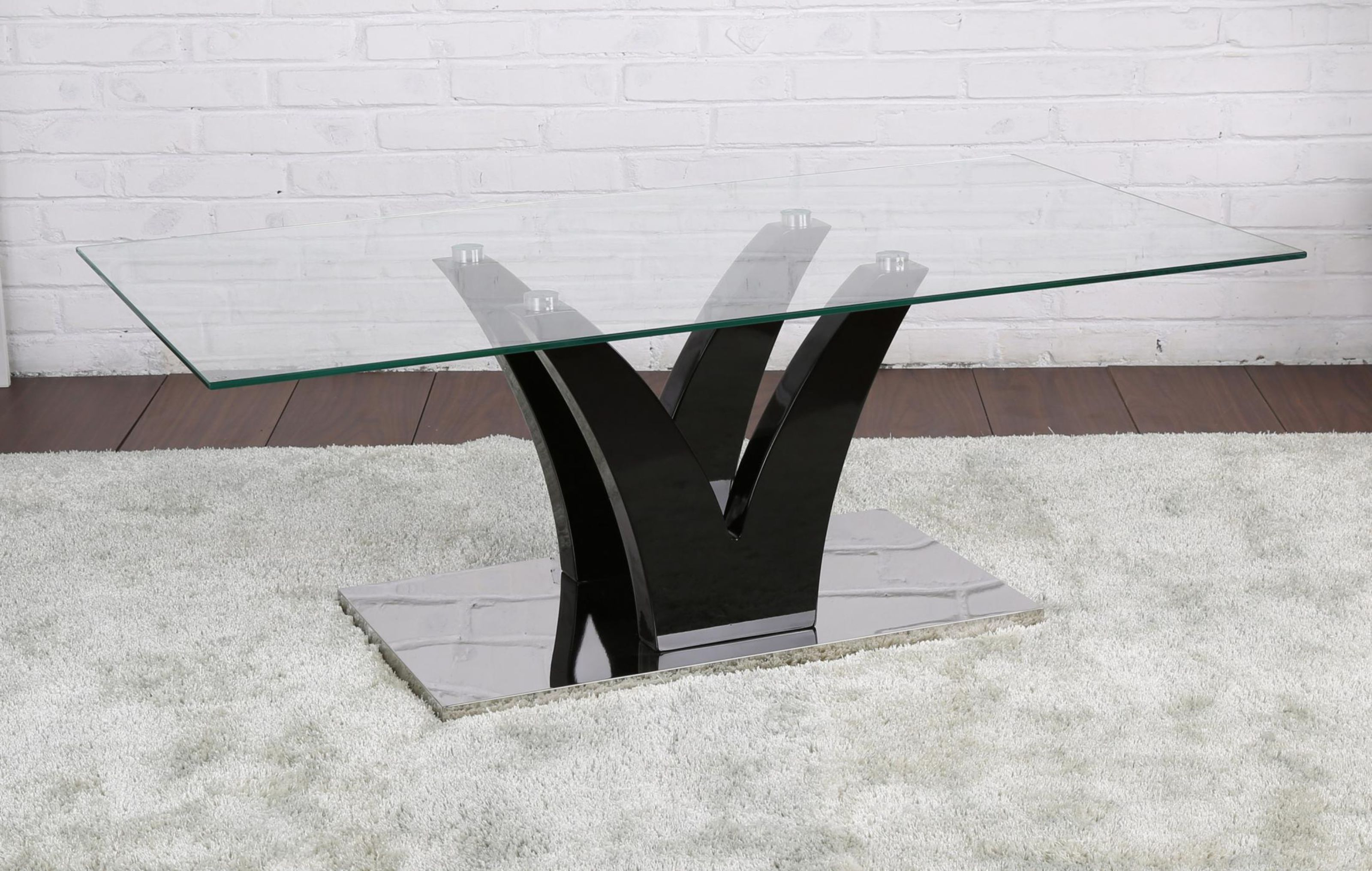 Picture of: Oscar Clear Glass Coffee Table With Black High Gloss Legs And Stainless Steel Base Designer Sofas4u